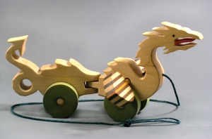 Take this Dragon on a flying adventure. The wings spin as to rolls along the floor.
